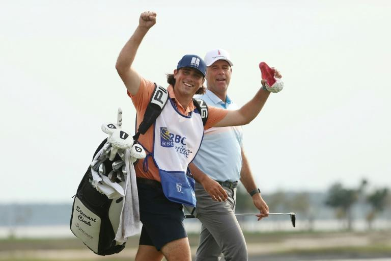 Winning combination: Stewart Cink, right, with son Reagan on the bag