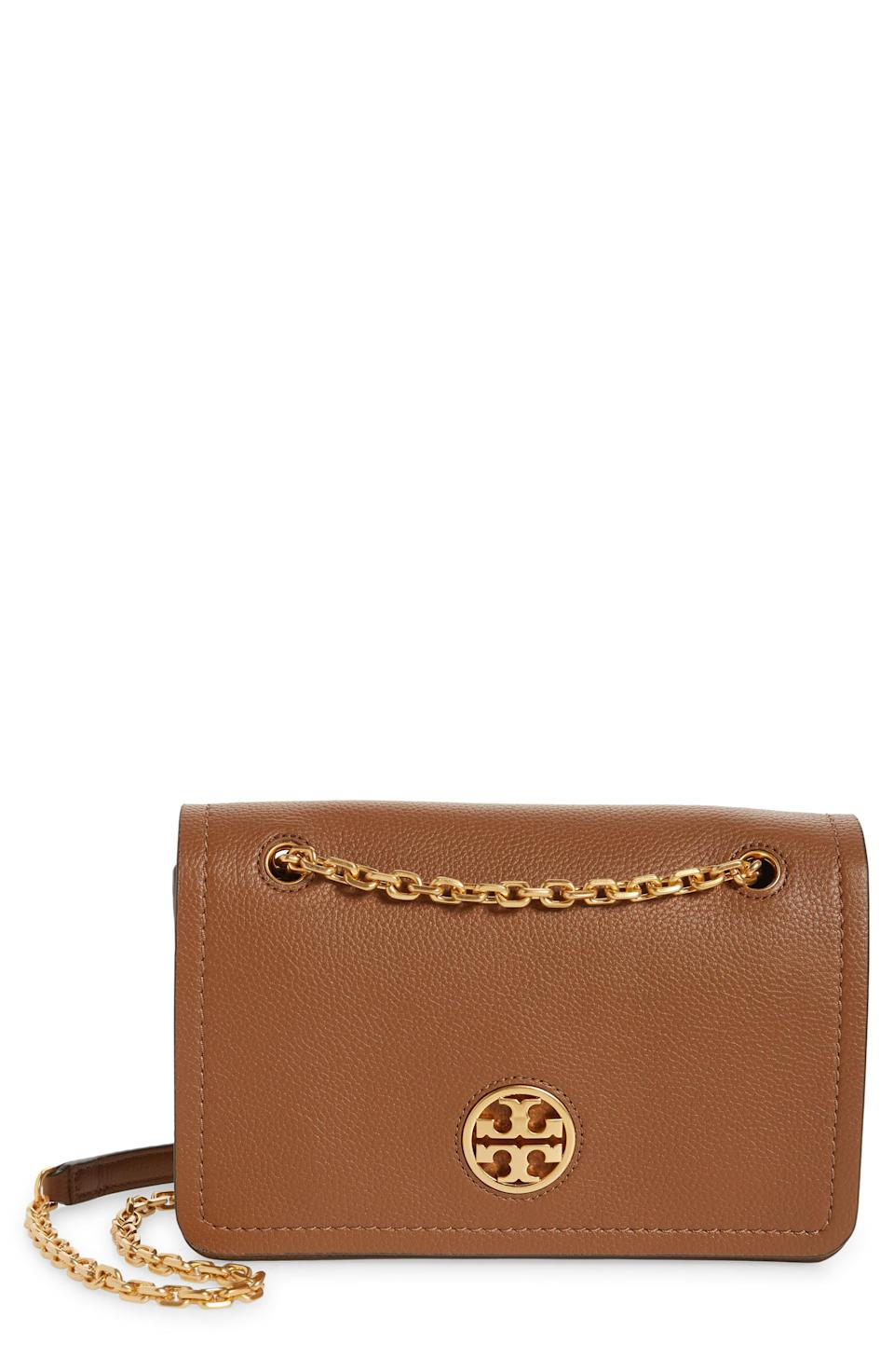 """<p><strong>Tory Burch</strong></p><p>nordstrom.com</p><p><a href=""""https://go.redirectingat.com?id=74968X1596630&url=https%3A%2F%2Fwww.nordstrom.com%2Fs%2Ftory-burch-carson-convertible-leather-crossbody-bag%2F5609951&sref=https%3A%2F%2Fwww.elle.com%2Ffashion%2Fshopping%2Fg33444637%2Fnordstrom-anniversary-sale-2020%2F"""" rel=""""nofollow noopener"""" target=""""_blank"""" data-ylk=""""slk:Shop Now"""" class=""""link rapid-noclick-resp"""">Shop Now</a></p><p><del>$498</del></p><p><strong>$299.90</strong></p>"""