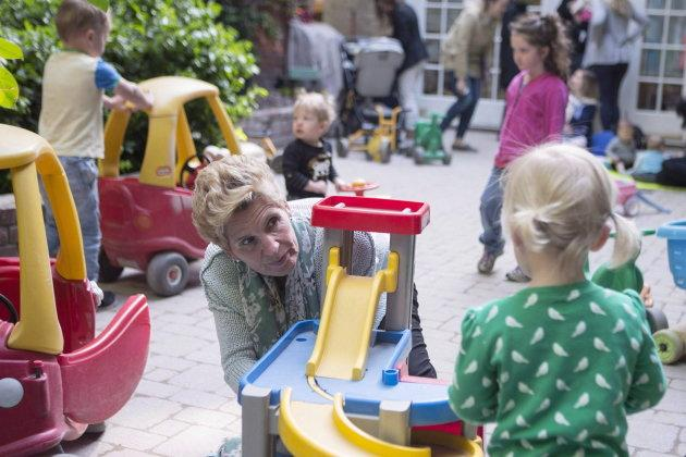 Former Ontario premier Kathleen Wynne visits a daycare in Toronto on May 18, 2018. Her government had budgeted billions of dollars to create free child care for kids, from the age of two-and-a-half until kindergarten.