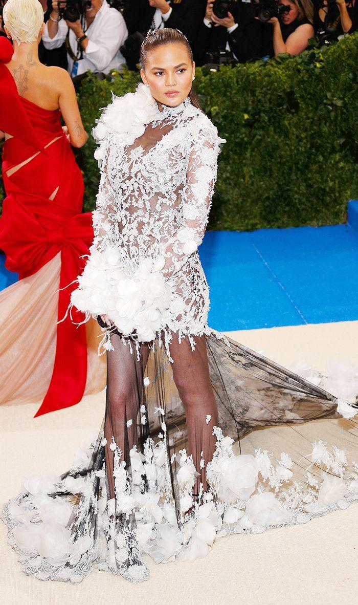 This is the most extravagant of all the dress codes—perhaps that's why the Met Gala utilized it in 2014. Think full ball gown, elbow-length gloves, and all your best jewelry. What to Wear: A floor-length evening gown (mandatory), gloves (optional), and your best jewelry. Your dress should incorporate luxe fabrications, like lace, silk, and chiffon.