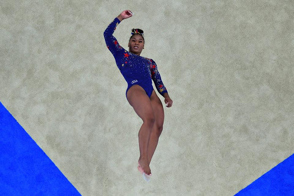 <p>USA's Jordan Chiles competes in the floor event of the artistic gymnastic women's qualification during the Tokyo 2020 Olympic Games at the Ariake Gymnastics Centre in Tokyo on July 25, 2021. (Photo by Antonin THUILLIER / AFP) (Photo by ANTONIN THUILLIER/AFP via Getty Images)</p>