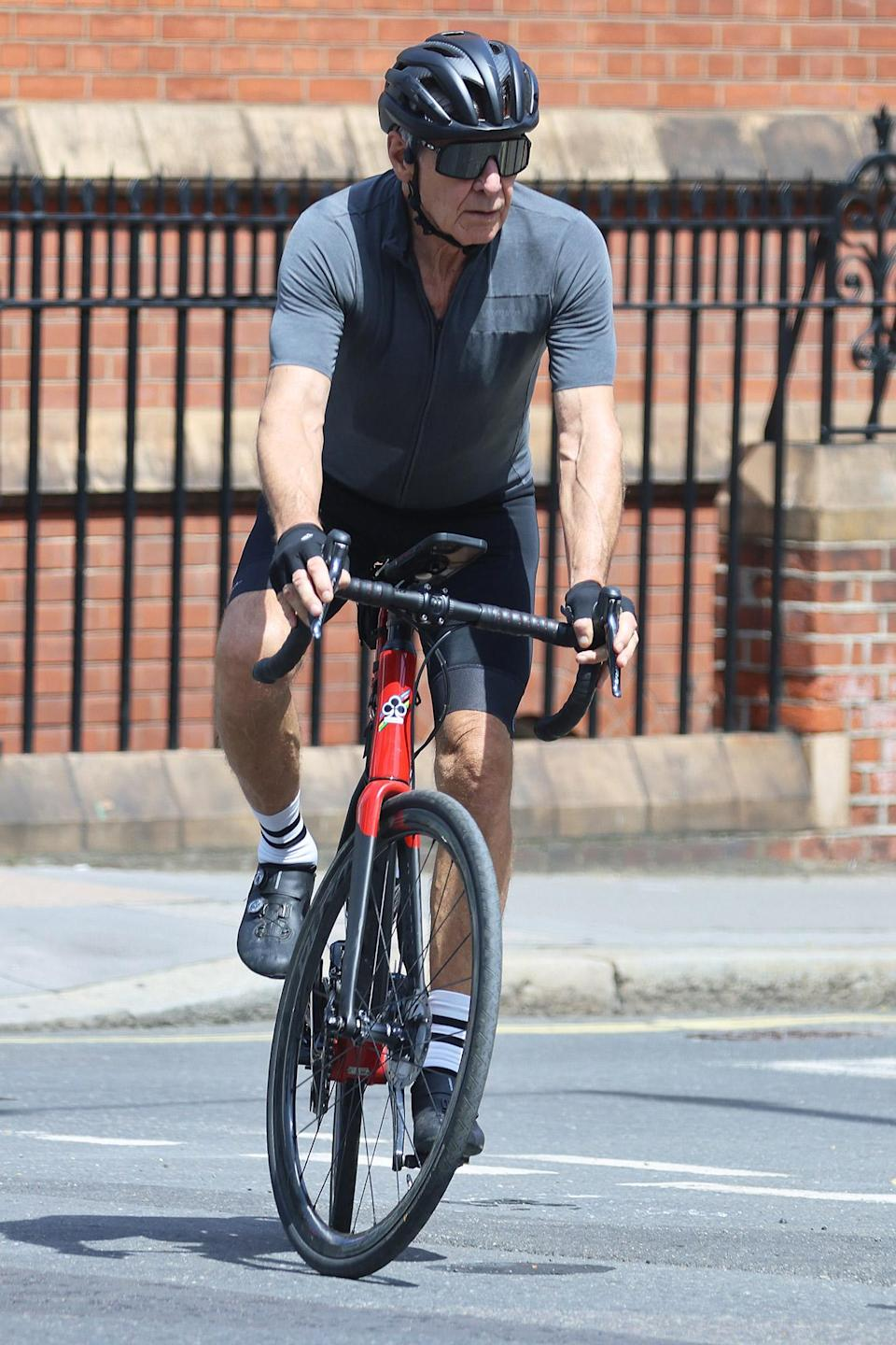 <p>Harrison Ford rides his bike through Mayfair on July 23 in London.</p>