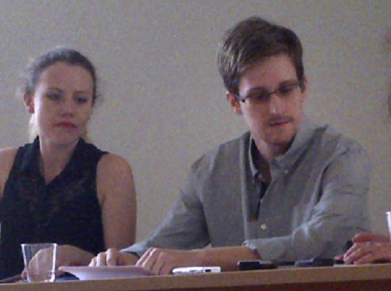 FILE - In this image provided by Human Rights Watch, NSA leaker Edward Snowden, center, attends a news conference at Moscow's Sheremetyevo Airport with Sarah Harrison of WikiLeaks, left, Friday, July 12, 2013. The whole time Snowden has been seeking asylum, Harrison has been by his side. She has emerged as a central, if mysterious, figure in the saga that has taken Snowden across the world in an attempt to evade U.S. espionage charges. (AP Photo/Human Rights Watch, Tanya Lokshina, File)