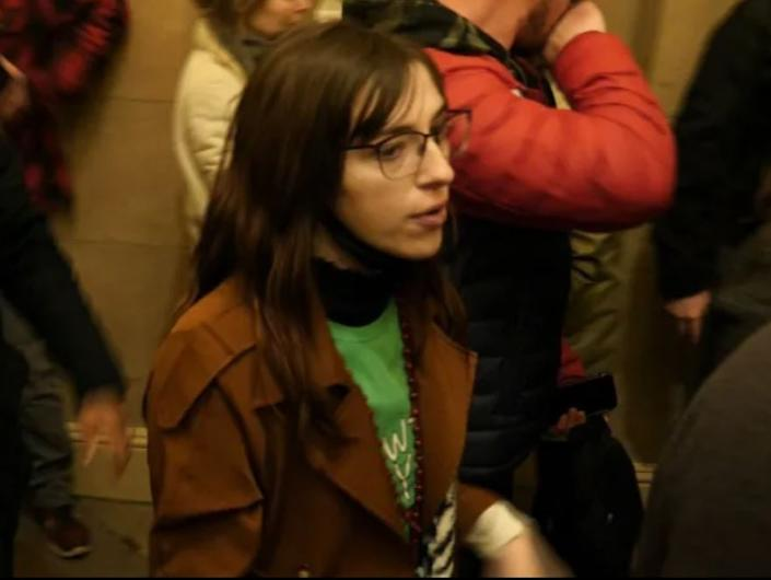 A woman identified as Riley June Williams inside the Capitol building during the riotITV News