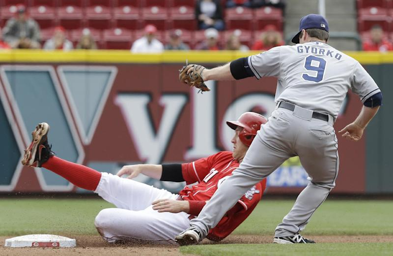 San Diego Padres second baseman Jedd Gyorko (9) tags out Cincinnati Reds' Todd Frazier trying to steal second base in the fourth inning of a baseball game, Thursday, May 15, 2014, in Cincinnati. (AP Photo/Al Behrman)