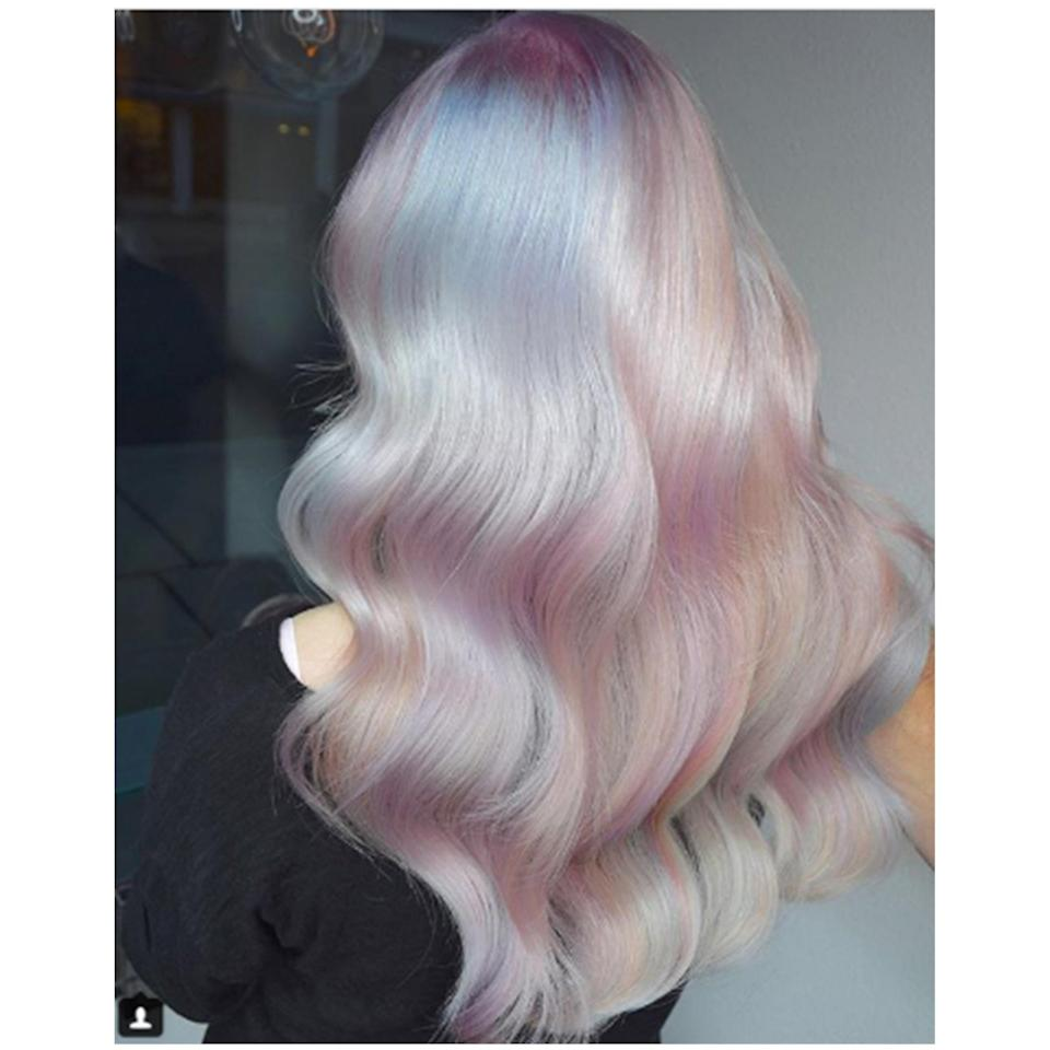 "The stylists of the Ross Michaels salon in Seattle used Pravana's Vivid Crystals collection to create this gorgeous creation that <a href=""https://www.allure.com/story/hollywood-opal-hair-color?mbid=synd_yahoo_rss"" rel=""nofollow noopener"" target=""_blank"" data-ylk=""slk:went viral on Instagram"" class=""link rapid-noclick-resp"">went viral on Instagram</a>."