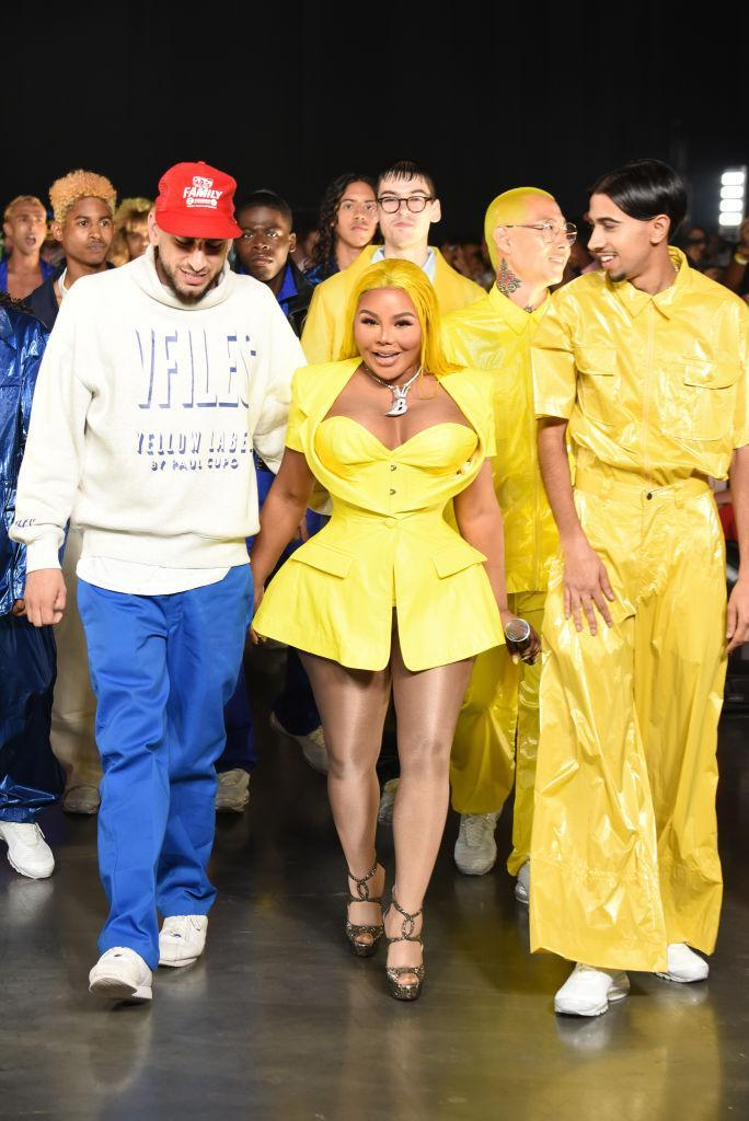 <p>Musician Lil' Kim, designer Paul Cupo, and models walk the runway at the VFiles show during New York Fashion Week at Barclays Center in Brooklyn, New York, on Sept. 5, 2018. (Photo: Albert Urso/Getty Images) </p>