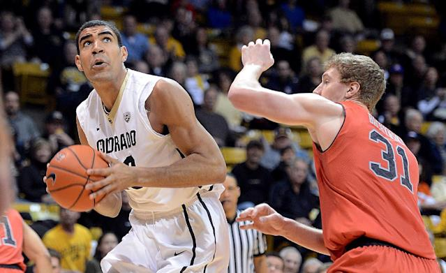 Colorado's Josh Scott, left, looks to shoot as Utah;s Dallin Bachynski defends during the first half of an NCAA college basketball game Saturday, Feb. 1, 2014, in Boulder, Colo. (AP Photo/The Daily Camera, Cliff Grassmick)