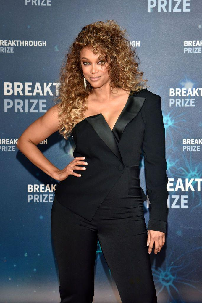 <p>Tyra Banks takes us back to the 1980s with this larger-than-life fluffy curly hairstyle. So fun!</p>