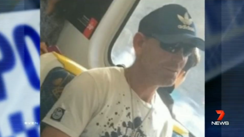 A woman subjected to a vicious racial attack on a train has risked her safety to take a photograph of the man who was abusing her. Photo: 7 News