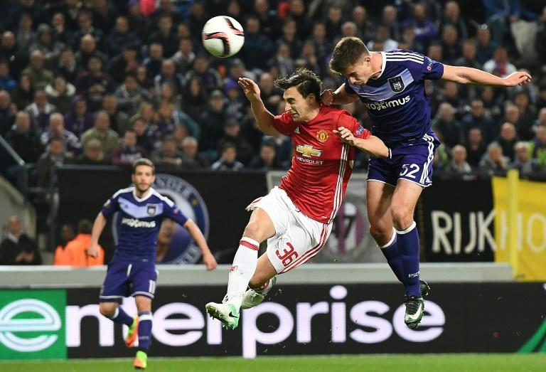 RSC Anderlecht's Belgian midfielder Leander Dendoncker (R) scores past Manchester United's Matteo Darmian during their UEFA Europa League first leg quarter-final match at the Constant Vanden Stock stadium in Brussels on April 13, 2017