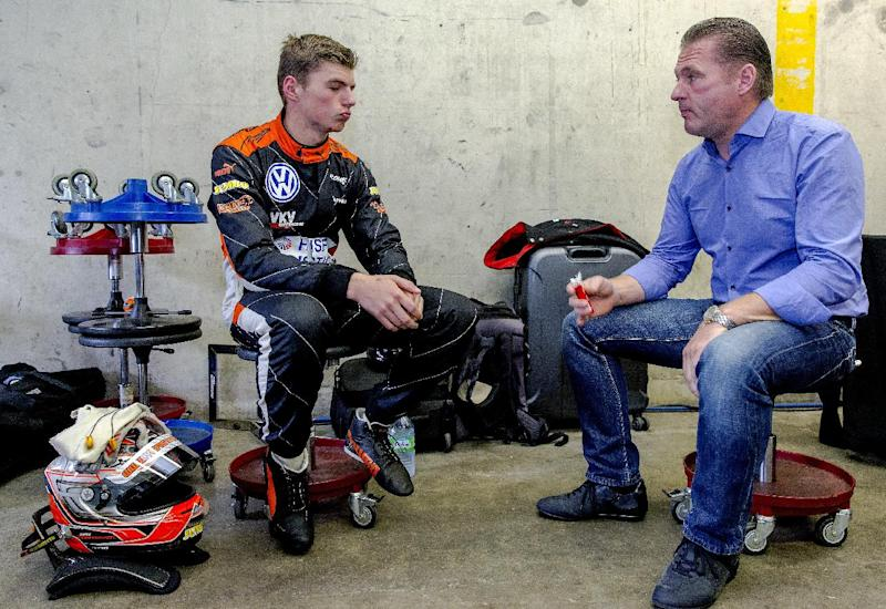 Dutch racing driver Max Verstappen (L) speaks with his father and former F1 driver Jos Verstappen prior to the of Formula 3 Zandvoort Masters Zandvoort, The Netherlands on July 6, 2014 (AFP Photo/Sander Koning)