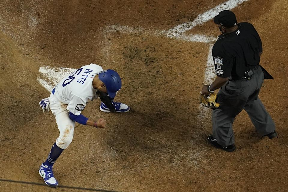 Dodgers' Mookie Betts reacts after scoring on a fielders choice.