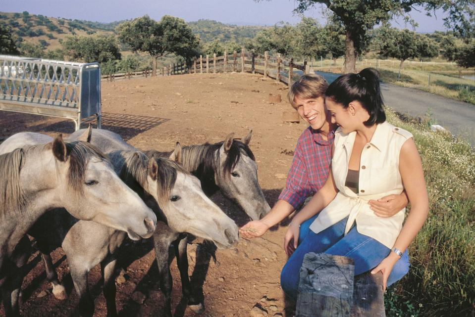 Manuel Diaz ´El Cordobes´ and his wife Vicky Berrocal in the country Feeding their horses in his property ´El cerro negro´  (Photo by Luis Davilla/Cover/Getty Images)