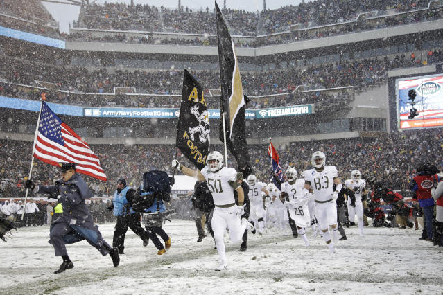 Army takes the field before the first half of an NCAA college football game against the Navy, Saturday, Dec. 9, 2017, in Philadelphia. (AP Photo/Matt Rourke)