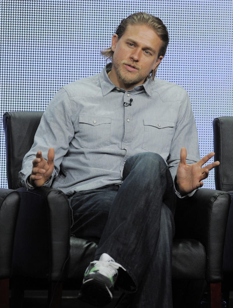 "FILE - In this Friday, Aug. 2, 2013 file photo, Charlie Hunnam, a cast member in the FX series ""Sons of Anarchy,"" answers a reporter's question during the FX 2013 Summer TCA press tour in Beverly Hills, Calif. Just weeks after being cast as the lead of the high-anticipated big-screen version of ""Fifty Shades of Grey,"" Hunnam is dropping out of the film. Universal announced Saturday, Oct. 12, 2013 that the actor who was to play Christian Grey will depart the project. The studio called it a mutual decision because Hunnam's preparation time was limited by his television schedule. (Photo by Chris Pizzello/Invision/AP)"