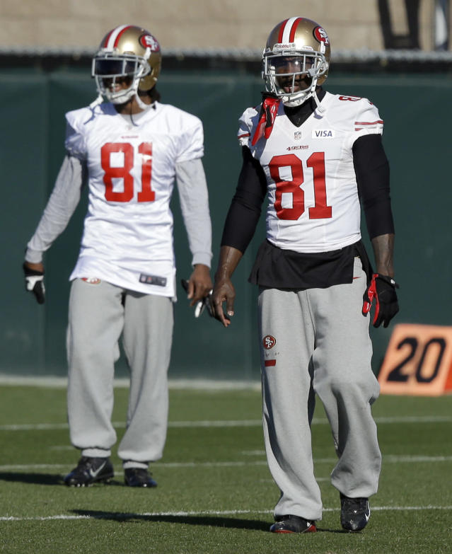 San Francisco 49ers' Anquan Boldin, right, walks on the field during NFL football practice in Santa Clara, Calif., Thursday, Jan. 16, 2014. The 49ers are scheduled to play the Seattle Seahawks for the NFC championship Sunday. (AP Photo/Ben Margot)