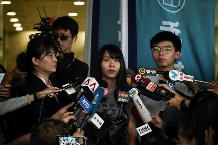 Joshua Wong and Agnes Chow, two of the Umbrella Movement's leaders, are still well-regarded among the Hong Kong youth (AFP Photo/Lillian SUWANRUMPHA)