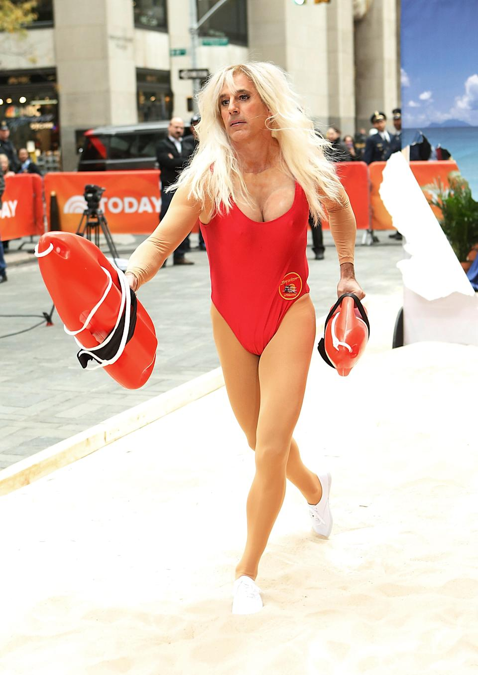<strong>Matt Lauer as Pamela Anderson on <em>Baywatch</em></strong><br><br>For <em>Today</em>'s 2013 Halloween bash, Lauer ran onstage in the classic <em>Baywatch </em>red one-piece.