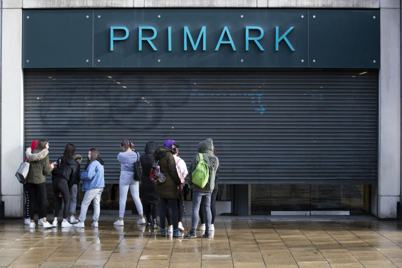 People queue outside the Primark store on Princes Street in Edinburgh, which reopens today as part of Scotland's phased plan to ease out of the coronavirus pandemic lockdown. (Photo by Jane Barlow/PA Images via Getty Images)