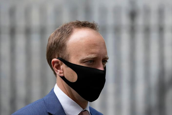 Health secretary Matt Hancock has said that the government was 'absolutely open' to delaying the lifting of restrictions if necessary (AP)
