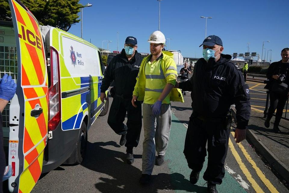 Police lead away a protester from Insulate Britain, as they block the A20 in Kent (Gareth Fuller/PA) (PA Wire)