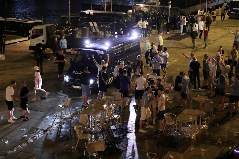 A police van tries to disperse supporters last night (AP)