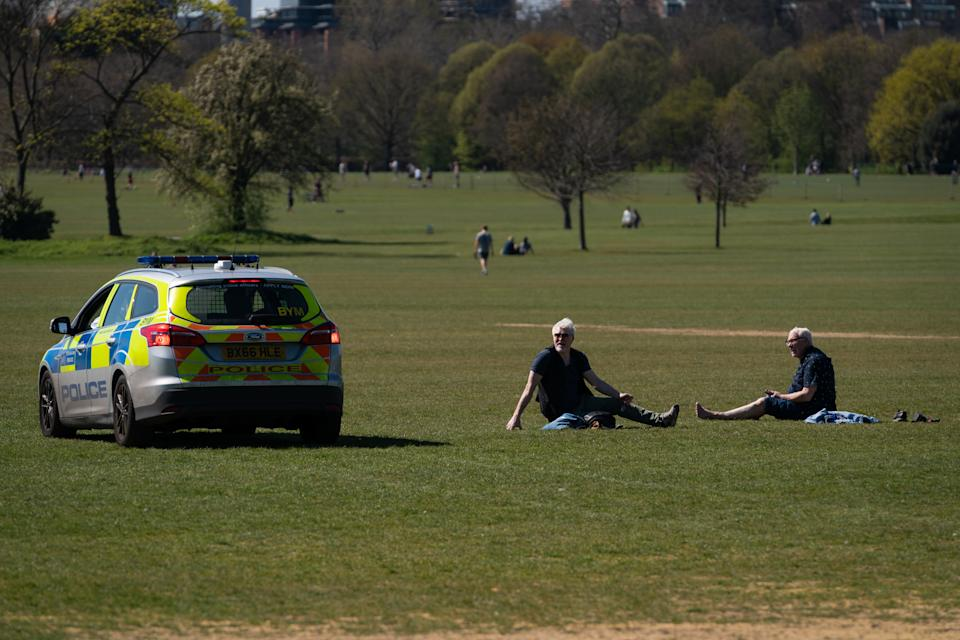 Police move on sunbathers in Regents Park, London, as the UK continues in lockdown to help curb the spread of the coronavirus. (Photo by Aaron Chown/PA Images via Getty Images)