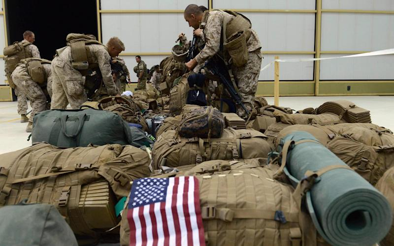 File image of US marines arranging their equipment as US troops arrive in Helmand Province - AFP or licensors