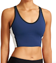 "<p>This performance-fitted top doesn't just look unbelievably sexy, but will stay snug even during the most gravity-defying poses. </p><p>$68 at <a href=""http://athleta.gap.com/browse/product.do?pid=153826022&vid=1&locale=en_US&kwid=1&sem=false&sdkw=highline-tank-P153826&brandCvoSid=YP7XVVP52MHK&sdReferer=http%3A%2F%2Fwww.athleta.com%2Fproducts%2Fderek-lam-athleta-collaboration.jsp"" rel=""nofollow noopener"" target=""_blank"" data-ylk=""slk:Athleta"" class=""link rapid-noclick-resp"">Athleta</a></p>"