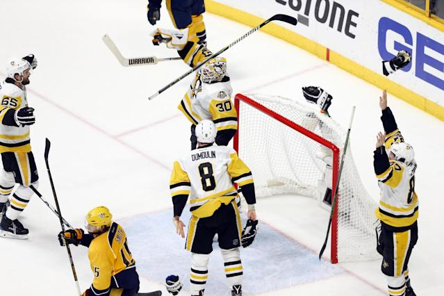 <p>Pittsburgh Penguins players celebrate after defeating the Nashville Predators in Game 6 of the 2017 Stanley Cup Final at Bridgestone Arena. Mandatory Credit: Aaron Doster-USA TODAY Sports </p>