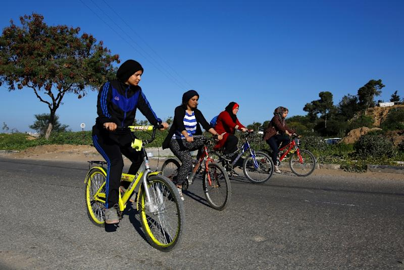 Four Palestinian women have turned heads in the Islamist-run Gaza Strip by riding their bicycles (AFP Photo/Mohammed Abed)