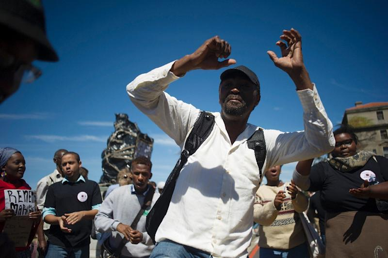 There has been a month of student protests against the statue of Cecil Rhodes at the university in Cape Town, a perceived symbol of historical white oppression (AFP Photo/Rodger Bosch)