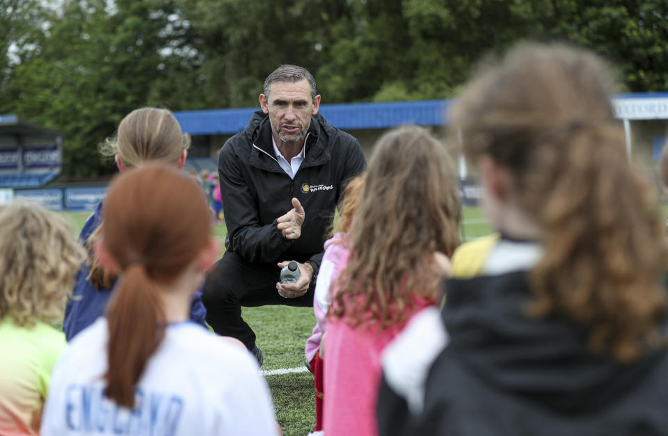 Martin Keown takes part in the McDonald's fun football session at Oxford City Football Club.