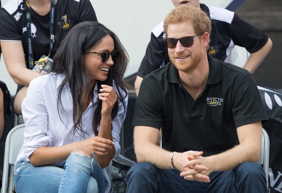 Meghan Markle stepped out for one of her first official appearances with Prince Harry in the now-iconic Misha Noonoo Husband shirt.