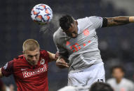 Bayern's Jerome Boateng heads his side's third goal during the Champions League group A soccer match between RB Salzburg and Bayern Munich in Salzburg, Austria, Tuesday, Nov. 3, 2020. (AP Photo/Andreas Schaad)