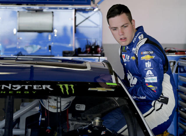 "<a class=""link rapid-noclick-resp"" href=""/nascar/nationwide/drivers/3188"" data-ylk=""slk:Alex Bowman"">Alex Bowman</a> climbs in his car during a practice session for the NASCAR Daytona 500 auto race at Daytona International Speedway, Saturday, Feb. 17, 2018, in Daytona Beach, Fla. (AP Photo/Terry Renna)"