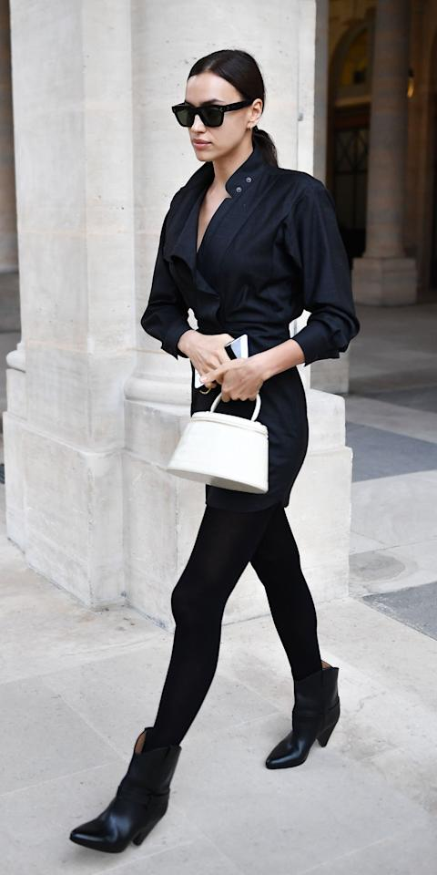 """<p>While in Paris, Irina stepped out wearing an Isabel Marant mini dress that's currently on sale (<strong>Shop now: </strong>$465; <a href=""""http://www.anrdoezrs.net/links/7799179/type/dlg/sid/IS%2CIrinaShayk%2Canesta%2C%2CIMA%2C3526964%2C202002%2CI/https://www.mytheresa.com/en-us/isabel-marant-etoile-valentine-virgin-wool-minidress-1295882.html"""" target=""""_blank"""">mytheresa.com</a>), a classic pair of Celine sunglasses (<strong>Shop similar:</strong> $360; <a href=""""https://click.linksynergy.com/deeplink?id=93xLBvPhAeE&mid=1237&murl=https%3A%2F%2Fshop.nordstrom.com%2Fs%2Fceline-55mm-polarized-cat-eye-sunglasses%2F5533785%2Ffull%3F&u1=IS%2CIrinaShayk%2Canesta%2C%2CIMA%2C3526964%2C202002%2CI"""" target=""""_blank"""">nordstrom.com</a>), and a tiny, white top-handle bag (<strong>Shop similar: </strong>$380; <a href=""""https://click.linksynergy.com/deeplink?id=93xLBvPhAeE&mid=1237&murl=https%3A%2F%2Fshop.nordstrom.com%2Fs%2Flongchamp-mini-le-pliage-cuir-leather-top-handle-bag%2F5439018%2Ffull%3F&u1=IS%2CIrinaShayk%2Canesta%2C%2CIMA%2C3526964%2C202002%2CI"""" target=""""_blank"""">nordstrom.com</a>). Bradley Cooper who?</p>"""