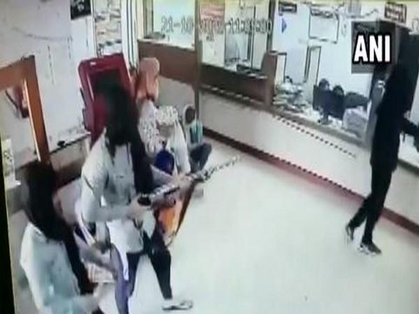 The armed men looted cash and snatched away the gun of the bank's security guard. (Photo/ANI)