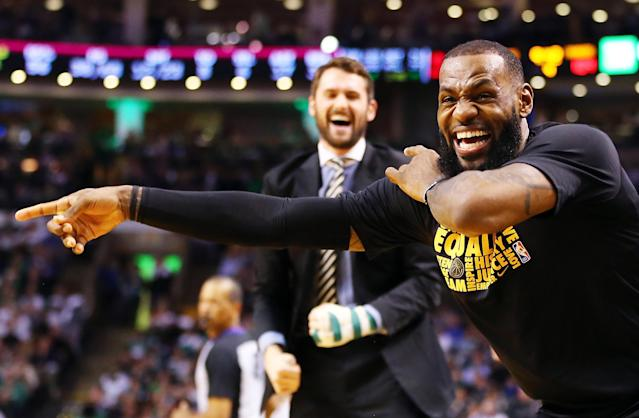 LeBron James is energized in a blowout win over the Celtics in Boston. (Getty)