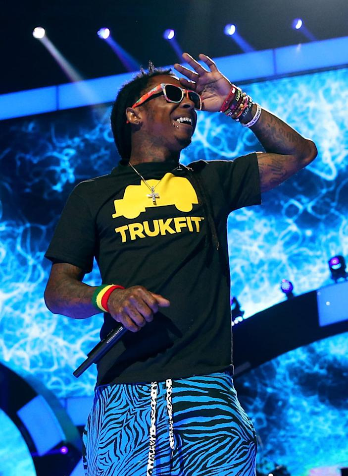 LAS VEGAS, NV - SEPTEMBER 21:  Rapper Lil' Wayne performs onstage during the 2012 iHeartRadio Music Festival at the MGM Grand Garden Arena on September 21, 2012 in Las Vegas, Nevada.  (Photo by Christopher Polk/Getty Images for Clear Channel)
