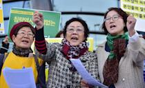 """South Korean former """"comfort woman"""" Lee Yong-Soo (C), who was forcibly recruited to work in Japanese wartime brothels, and supporters demonstrate near the Japanese embassy in Seoul on October 30, 2015 (AFP Photo/Jung Yeon-Je)"""