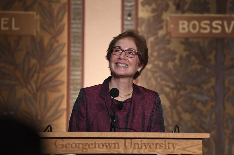 """Former Ambassador to Ukraine Marie Yovanovitch looks up at the audience as she speaks at Georgetown University in Washington, Wednesday, Feb. 12, 2020. She was awarded the 2020 J. Raymond """"Jit"""" Trainor Award for Excellence in the Conduct of Diplomacy. (AP Photo/Susan Walsh)"""