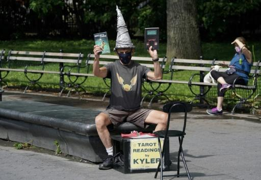 Fixture-and-tarot-card-wizard Kyler James sits in Washington Square Park in New York on June 9, 2020