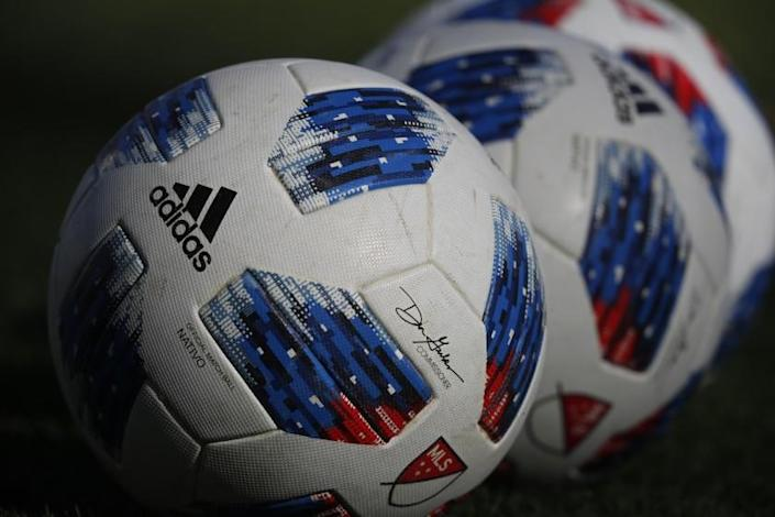 Adidas soccer balls in the first half of an MLS soccer match Sunday, Oct. 28, 2018, in Commerce City, Colo. (AP Photo/David Zalubowski)