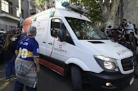 An ambulance carrying Diego Maradona leaves the clinic where he underwent brain surgery for a blood clot in Olivos, Buenos Aires