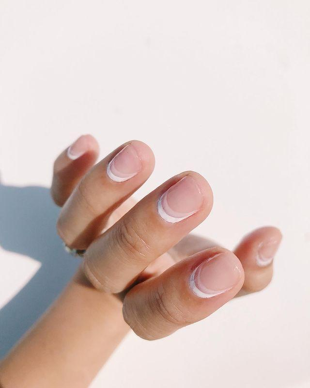 """<p>A bright white cuticle cuff alongside a softer nude one. An absolute leewk for shorter nails.</p><p><a href=""""https://www.instagram.com/p/B1q9OUrnIHj/"""" rel=""""nofollow noopener"""" target=""""_blank"""" data-ylk=""""slk:See the original post on Instagram"""" class=""""link rapid-noclick-resp"""">See the original post on Instagram</a></p>"""