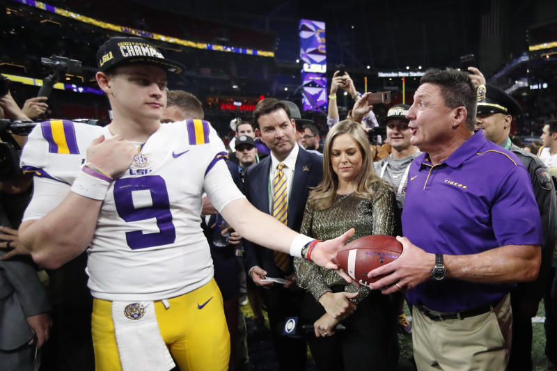 LSU quarterback Joe Burrow and LSU head coach Ed Orgeron celebrate after the SEC championship on Dec. 7. (AP)