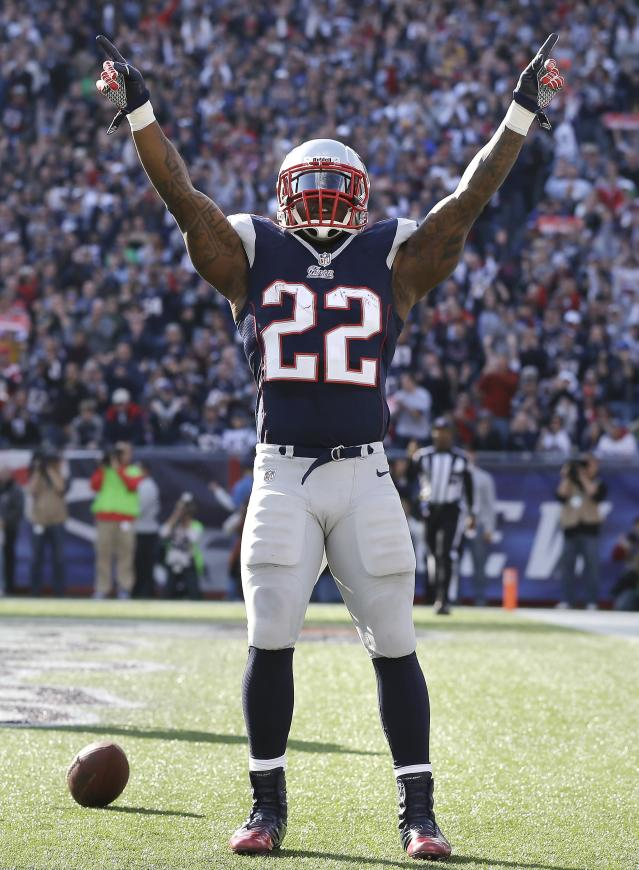 New England Patriots running back Stevan Ridley (22) celebrates after his touchdown during the first quarter of an NFL football game against the Buffalo Bills at Gillette Stadium in Foxborough, Mass., Sunday, Nov. 11, 2012. (AP Photo/Elise Amendola)
