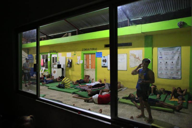 Male migrants bed down for the night on mattresses on the ground in the entry court of the Good Shepherd shelter in Tapachula, Mexico, Tuesday, June 18, 2019. Religious groups, mostly Catholic but including some Protestant denominations, have long operated shelters to aid migrants. (AP Photo/Rebecca Blackwell)
